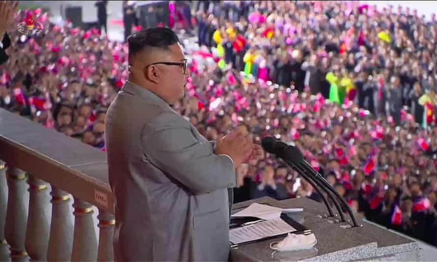 A screen grab taken from a KCNA broadcast shows the North Korean leader, Kim Jong-un, delivering a speech before the military parade.
