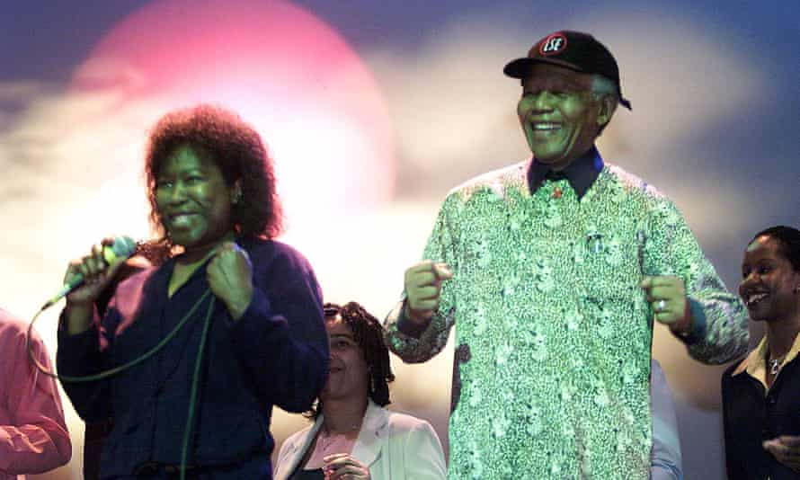 Armatrading dances with Nelson Mandela during his visit to the London School Of Economics in 2000.