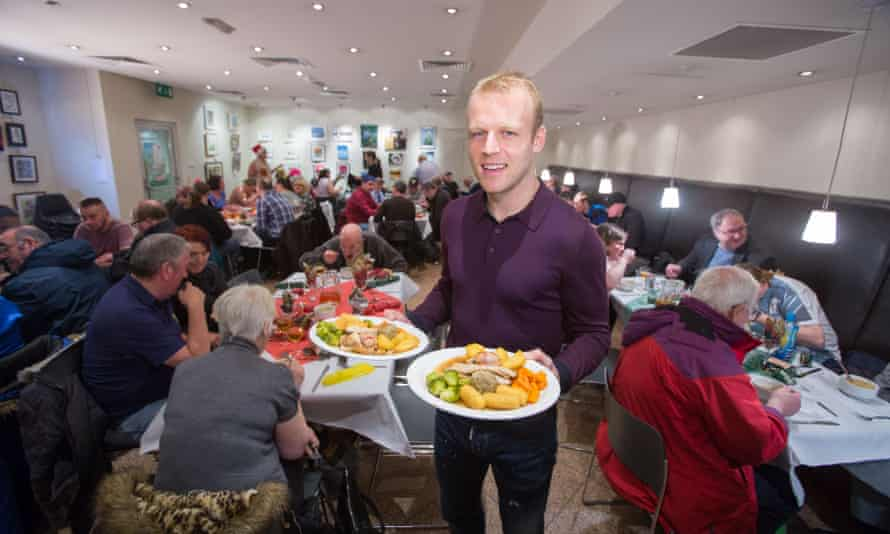 Everton and Scotland star Steven Naismith hands out the Christmas dinner at the Loaves and Fishes charity Christmas Lunch for the homeless.
