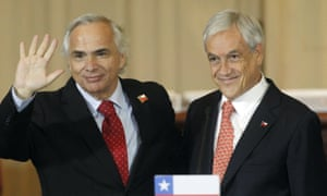 Sebastian Piñera, right, presents Andres Chadwick as his new interior minister.