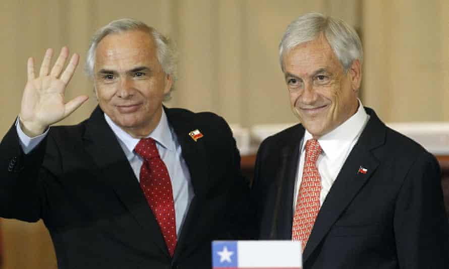 Sebastian Piñera, right, presents Andres Chadwick as his new interior minister.