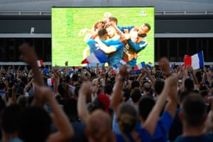 People celebrate France's victory at a fan zone in Rennes.