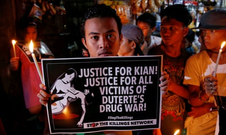 Protesters gather at the wake of Kian Loyd delos Santos, a 17-year-old high school student, who was among the people shot dead in 2017 in Manila