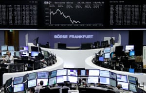 Traders are pictured at their desks in front of the DAX board at the Frankfurt stock exchange<br>Traders are pictured at their desks in front of the DAX board at the stock exchange in Frankfurt, Germany, September 24, 2015. REUTERS/Staff/remote