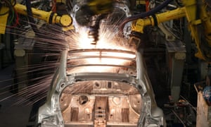 Robotic arms assemble and weld the body shell of a Nissan car on the production line at Nissan's Sunderland plant in 2013.