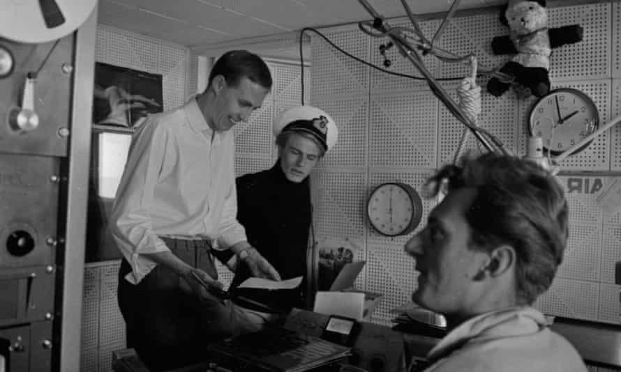 Adam Faith, wearing a nautical cap, with DJ Simon Dee, left, aboard pirate station Radio Caroline, where some of Boom's veterans got their break.