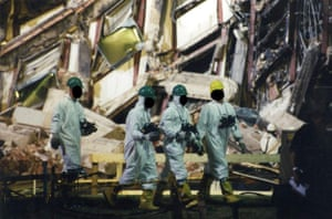 Forensic experts search the wreckage – their identities have been hidden