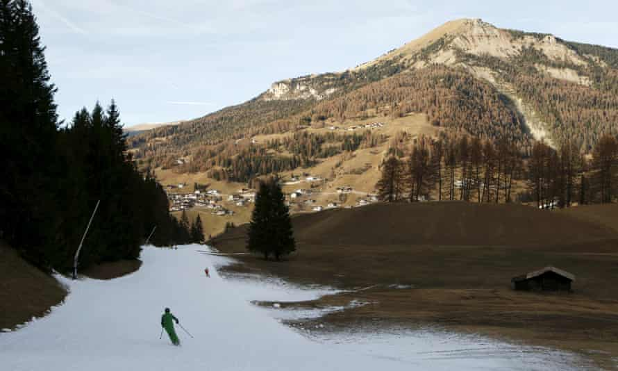 A man skies down a slope created with artificial snow in the Dolomite mountains in Val Gardena, northern Italy.