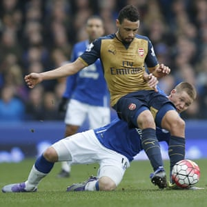 Coquelin working hard for his team by holding off Everton's McCarthy.