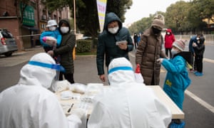 Members of the community health service center sample nucleic acids for close contacts who have been released from isolation, Wuhan, Hubei Province, China, February 25, 2020.