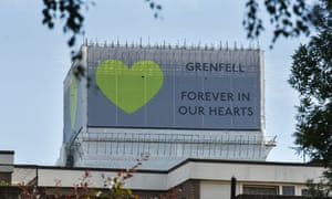 A Grenfell Tower banner: 'This anniversary marks not one life lost but 72'