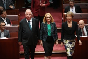 Amanda Stoker from Queensland, appointed to replace retiring senator George Brandis, arrives in the Senate chamber of Parliament House to be sworn in with Nationals senator Barry O'Sullivan and the employment minister, Michaelia Cash