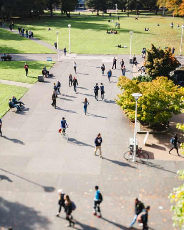 High View Of People - Students - Walking On College Campus