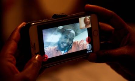 Tiffany Burns tries to talk to her boyfriend Chrishon Brown, who is locked up in Jefferson Parish jail.