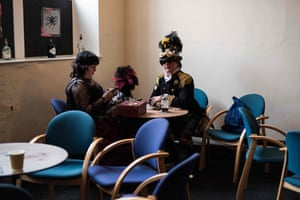Steampunk enthusiasts enjoy a drink in Haworth Village Hall as they attend the sixth annual Haworth Steampunk Weekend in Haworth, northern England
