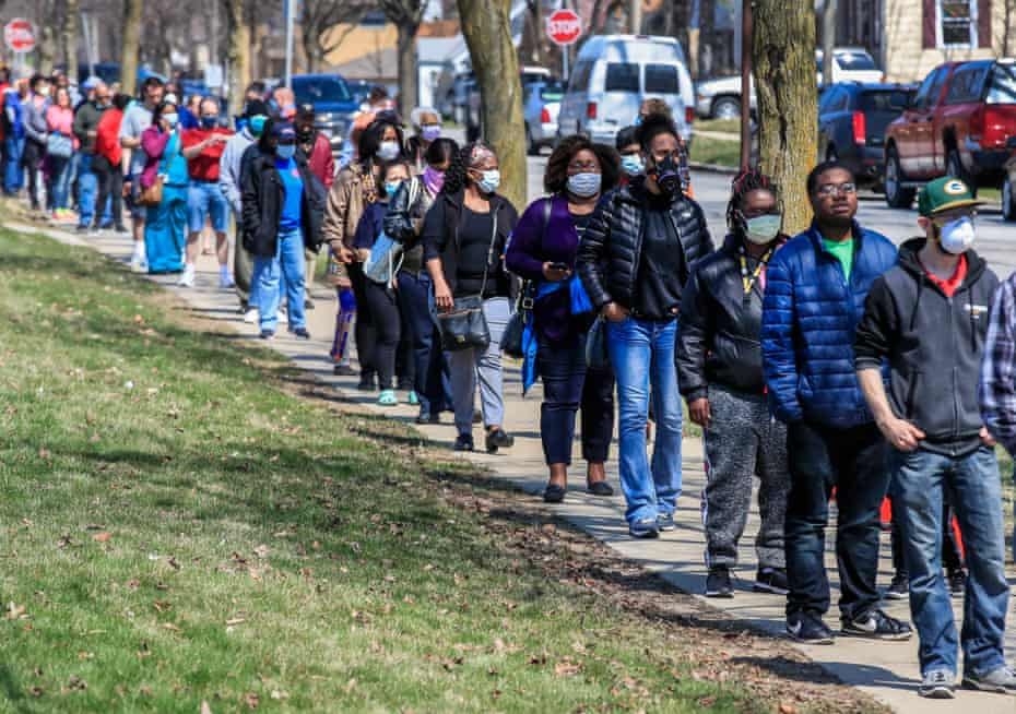 Voters wait in line to cast their ballots in the Wisconsin presidential primary election.