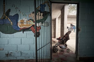 A baby sleeps in his pram at the prison, which has its own nursery
