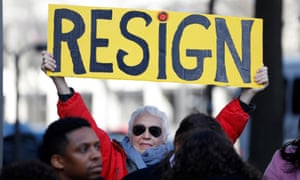 A demonstrator holds a sign during a protest to call for the resignation of Jeff Sessions on 2 March 2017 in Washington DC.