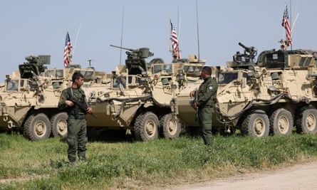 Kurdish YPG fighters guard  US military vehicles