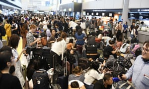 Passengers are stranded at Narita airport in Tokyo after railways and subway operators suspended their services following the passage of Typhoon Faxai.
