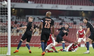Alexandre Lacazette of Arsenal scores from a diving header to make it 1-1.