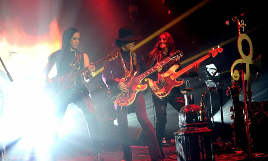 Prince with Donna Grantis and Ida Nielsen of 3RDEYEGIRL performing at the Hollywood Palladium in 2014.