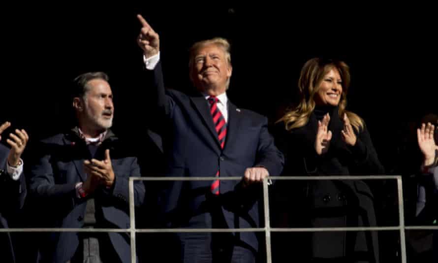 Donald Trump and Melania Trump soak up cheers at Bryant-Denny Stadium, in Tuscaloosa.