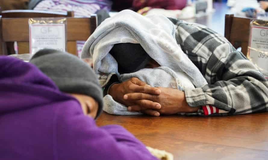 People take shelter at a furniture store that transformed into a warming station during the blackouts in Houston, Texas, on 17 February.