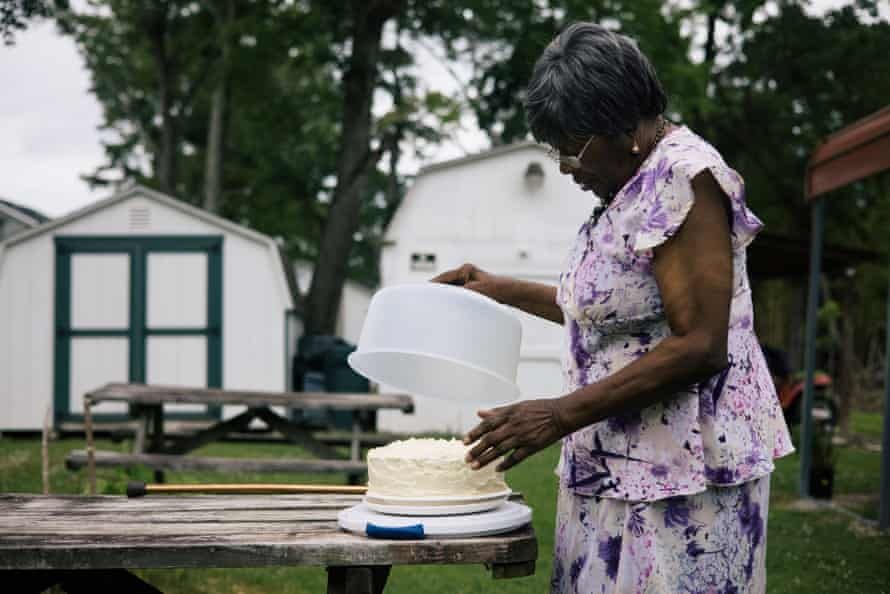 Suffolk, VA -- Catherine Jones preps a Father's Day cake to share with family in her backyard, which floods whenever heavy rain falls.