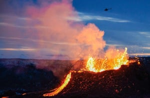Reykjanes Peninsula, IcelandA helicopter flies near above the lava flowing from a fissure near the Fagradalsfjall