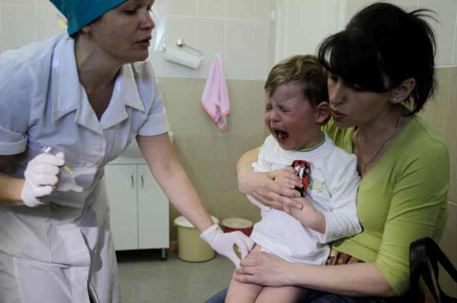 A child is vaccinated against diphtheria, whooping cough and tetanus in a children's hospital in Kiev, Ukraine