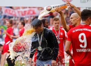 Bayern Munich's Arjen Robben pours beer on Bayern Munich coach Niko Kovac as they celebrate winning the Bundesliga.