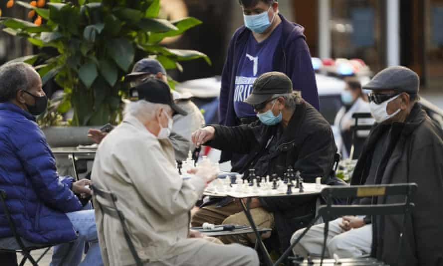 People wearing face masks play chess at Bryant Park in New York, the United States, November 6, 2020.