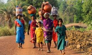 Gond women and children return from market.