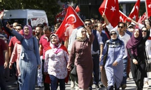 People gather outside parliament building in Ankara
