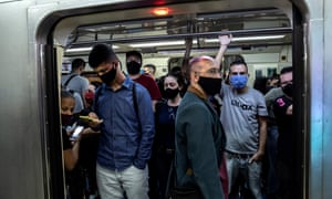 Passengers wearing face masks at the Se metro station in downtown São Paulo, Brazil