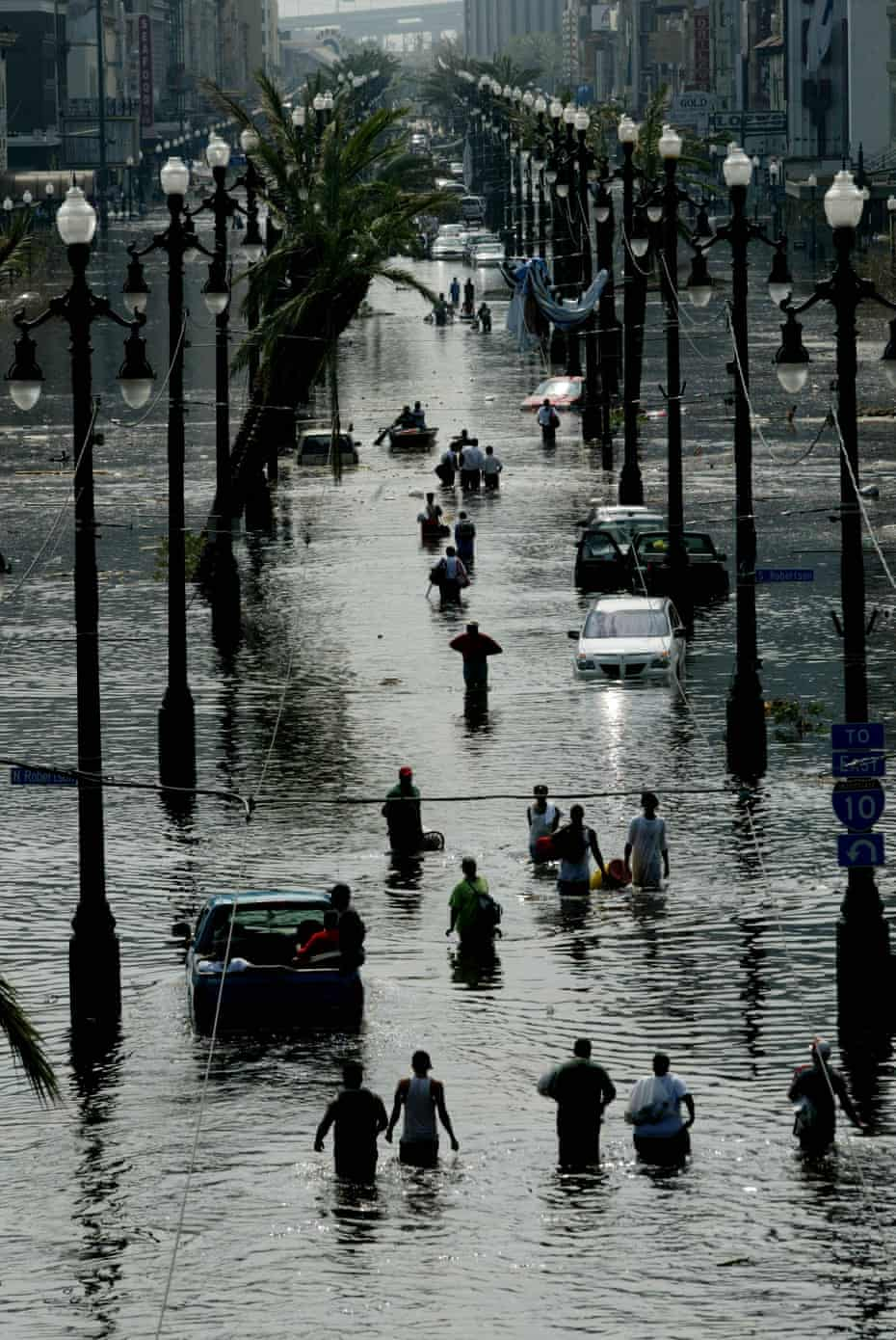Stranded people make their way along Canal Street in New Orleans on 30 Aug 2005 as Hurricane Katrina struck