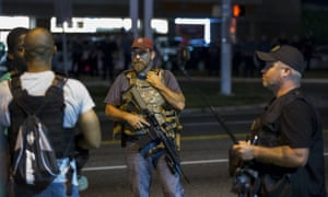 Members of the Oath Keepers walk with their personal weapons on the street during protests in Ferguson, Missouri .