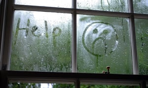 Sad face drawn in window condensation