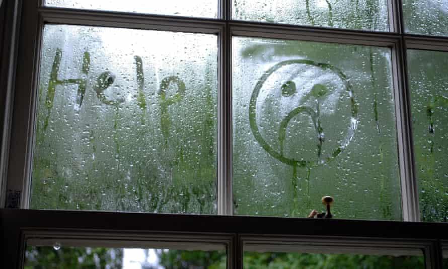Sad face drawn in window condensation