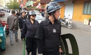 Police on patrol in Urumqi, the capital of Xinjiang.