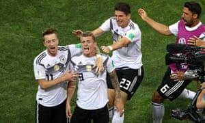 Germany's Toni Kroos celebrates scoring their dramatic winner against Sweden.