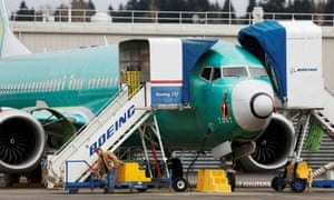 An employee works near a 737 Max aircraft at Boeing's 737 Max production facility in Renton, Washington, US