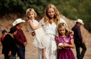 Friends and relatives mourn the victims who died in the gun attack. Six children and three women – all US citizens – were massacred on dirt road when gunman attacked their convoy.