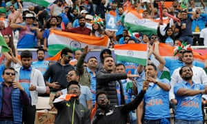 India fans celebrate a four from KL Rahul during their team's World Cup match against South at the Ageas Bowl.