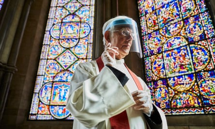 The Very Reverend Robert Willis wears a protective mask and gloves as Cantebury Cathedral prepares to reopen for public worship