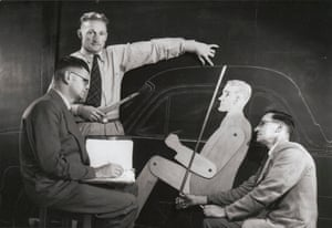 Mr. Lewis Bandt, a designer at Ford, with two colleagues working with a mannequin to test lumbar support and seating position. Geelong, 1951