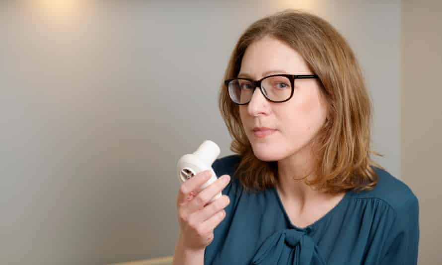 Sharon Brennan with a lung function measuring device. She sought help from peers on the internet when she found herself having trouble breathing late at night in Japan.