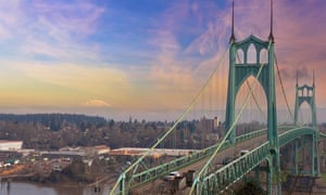 A view of St Johns Bridge and the Willamette River from Forest Park in Portland, Oregon.