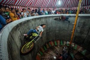 Purba rides around the Devil's Barrel as a fellow rider performs tricks